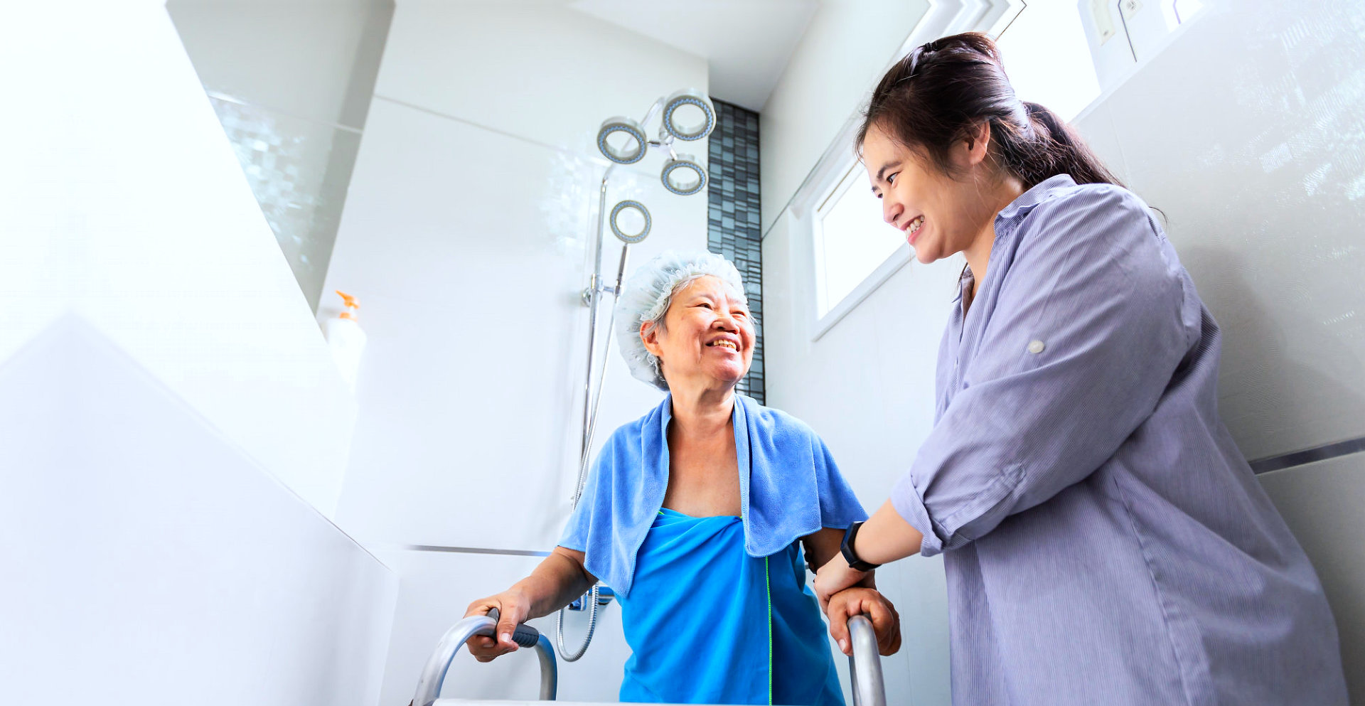 caregiver helping a patient after taking a bath