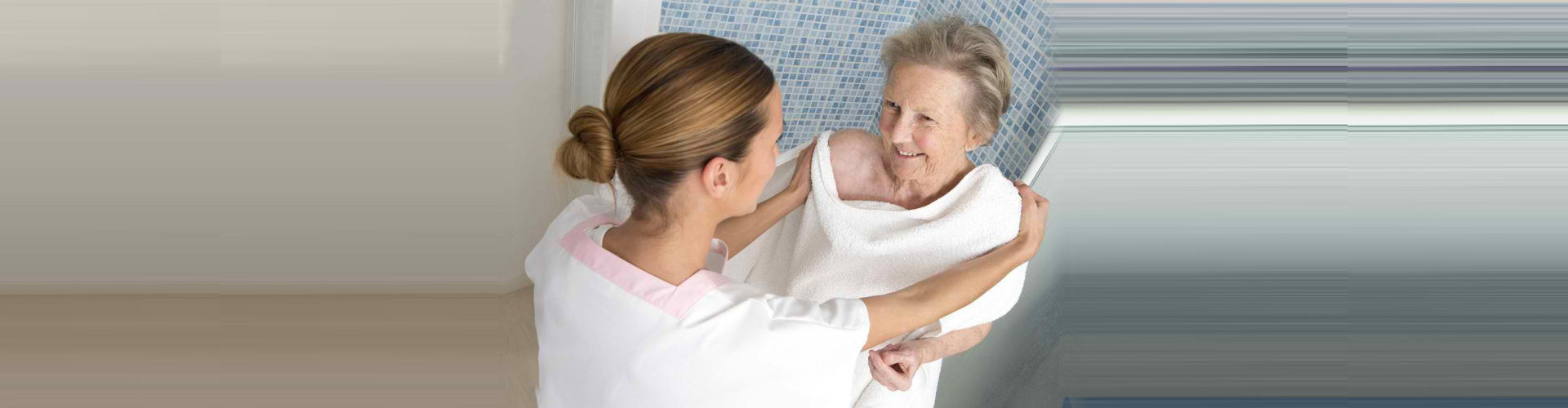 senior woman assisted by a caregiver